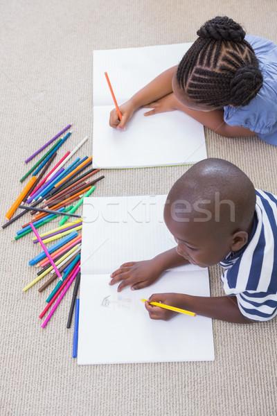 Siblings on the floor drawing  Stock photo © wavebreak_media