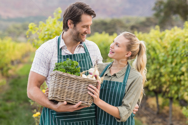Two young happy farmers holding a basket of vegetables Stock photo © wavebreak_media
