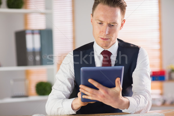Focused businessman using his tablet pc Stock photo © wavebreak_media