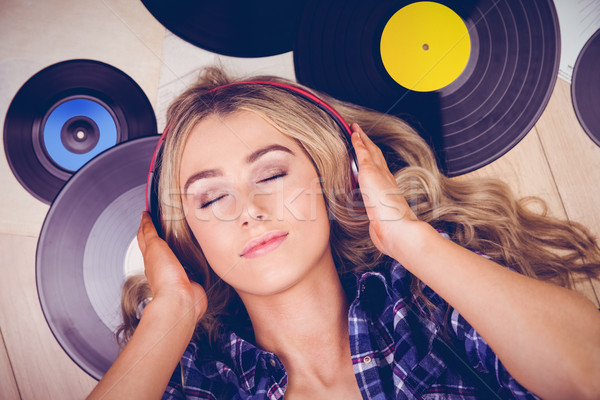A beautiful woman with headphones Stock photo © wavebreak_media