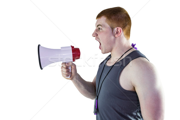 Angry personal trainer yelling through megaphone  Stock photo © wavebreak_media