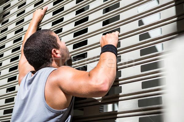 Extrém atléta lebilincselő fal város épület Stock fotó © wavebreak_media