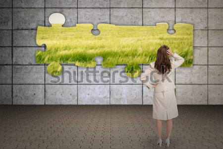 Woman covered her face with a cardboard box showing jigsaw puzzle piece Stock photo © wavebreak_media