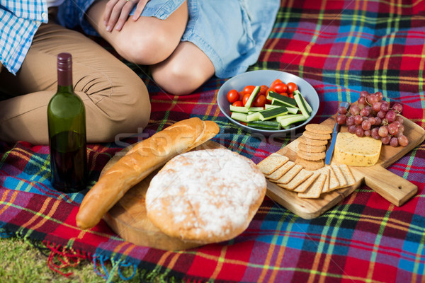 High angle view of wine bottle and food by couple Stock photo © wavebreak_media