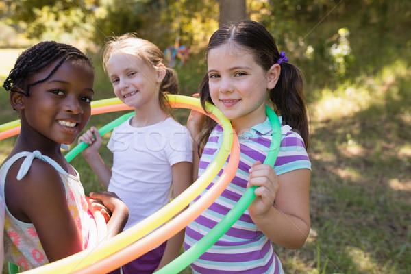 Girls wearing hula hoops around neck at campsite Stock photo © wavebreak_media