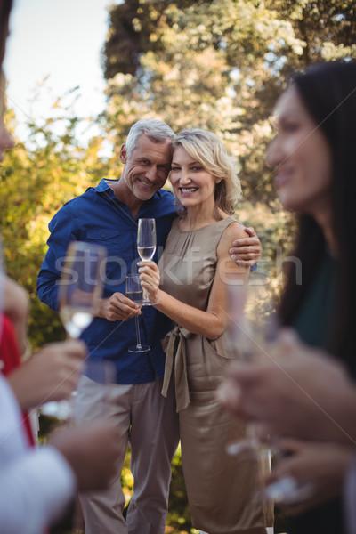 Szeretetteljes pár pezsgő erkély otthon nő Stock fotó © wavebreak_media