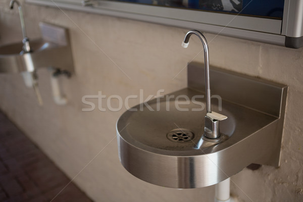 Stock photo: High angle view of drinking water faucet on sink