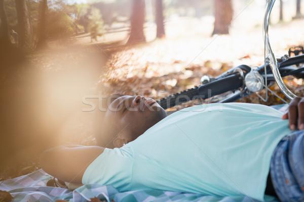 Stock photo: Man sleeping on a picnic blanket