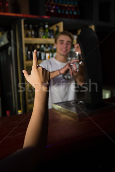 Customer giving placing order to bartender Stock photo © wavebreak_media