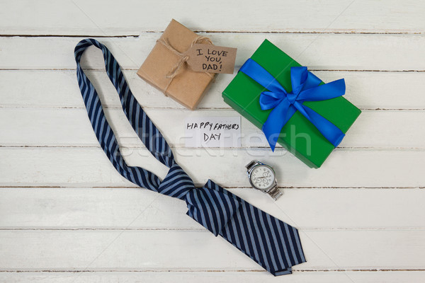 Happy fathers day text with gifts on table Stock photo © wavebreak_media
