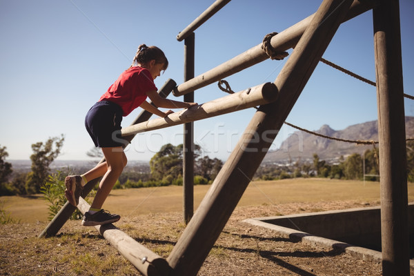 Girl exercising on outdoor equipment during obstacle course Stock photo © wavebreak_media