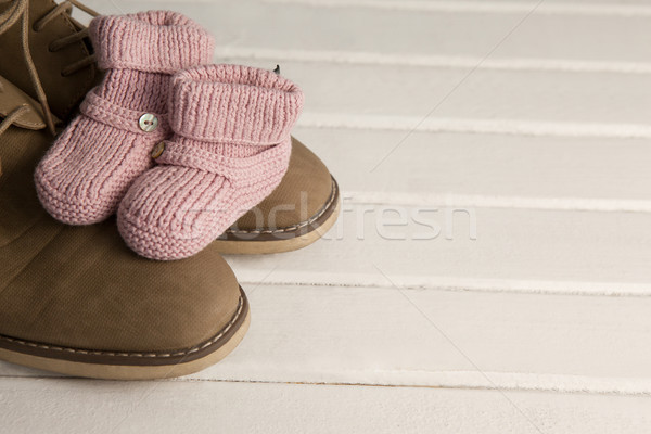 Pairs of child and fathers shoes on wooden plank Stock photo © wavebreak_media