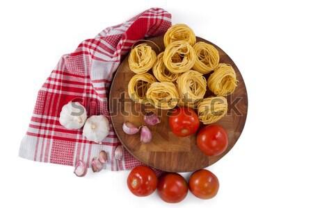 Raw fettuccine with tomatoes, garlic, onions and napkin cloth Stock photo © wavebreak_media