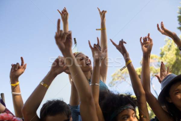 Cheerful woman with arms raised enjoying at music festival Stock photo © wavebreak_media