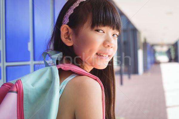 портрет улыбаясь девушки рюкзак коридор школы Сток-фото © wavebreak_media