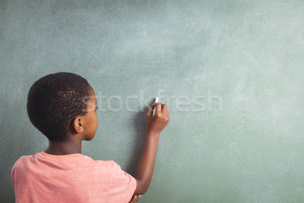 Chłopca piśmie kredy szkoły widok z tyłu dziecko Zdjęcia stock © wavebreak_media