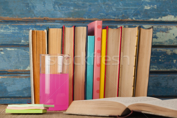 Stack of books, chemical beaker and sticky notes Stock photo © wavebreak_media