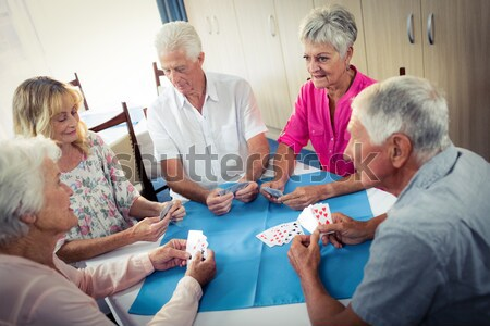 High angle view of smiling female doctor talking to seniors while sitting on chairs Stock photo © wavebreak_media