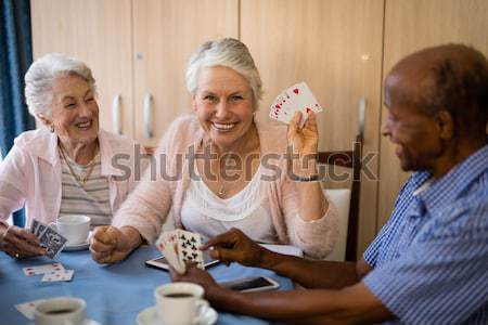 Smiling woman having coffee while sitting with friends Stock photo © wavebreak_media