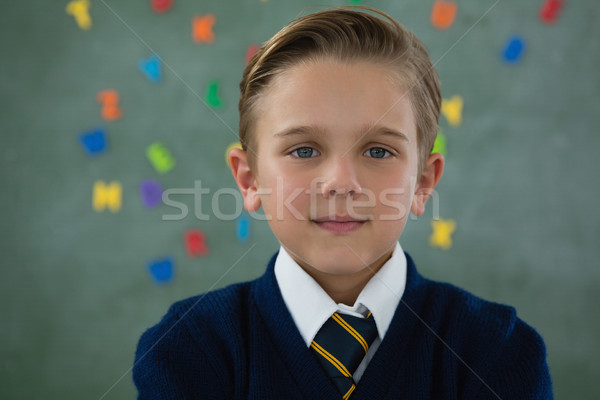 Souriant écolier permanent tableau portrait homme Photo stock © wavebreak_media