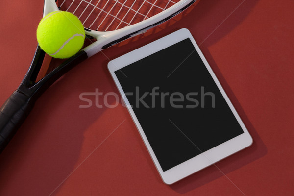 High angle view of tennis racket and ball by digital tablet Stock photo © wavebreak_media