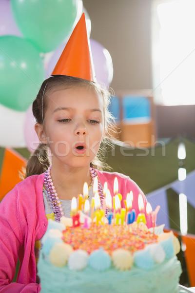 Birthday girl blowing birthday candles Stock photo © wavebreak_media