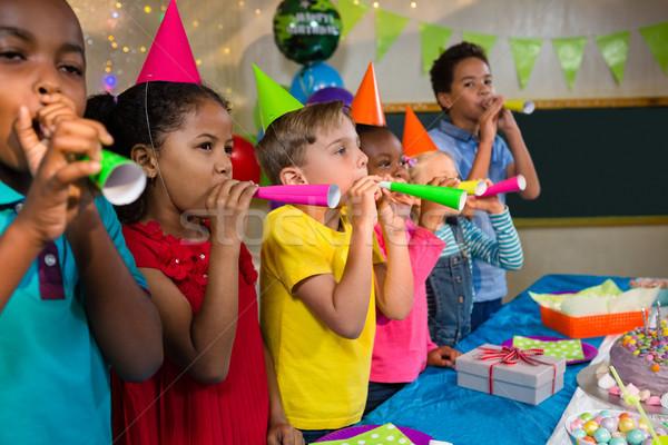 Játékos gyerekek fúj buli agancs áll Stock fotó © wavebreak_media