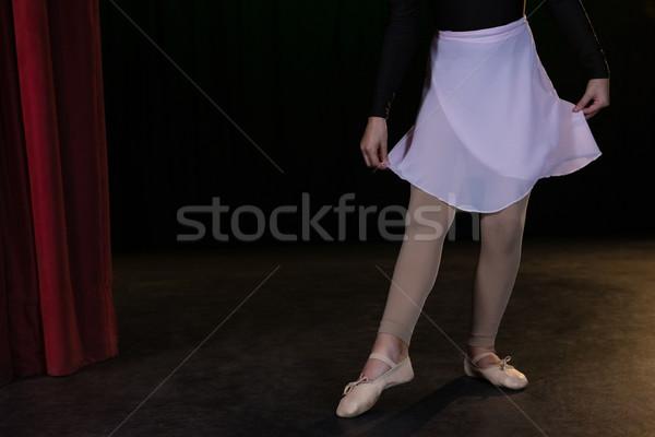 Mid-section ballerina practicing ballet dance in the stage Stock photo © wavebreak_media