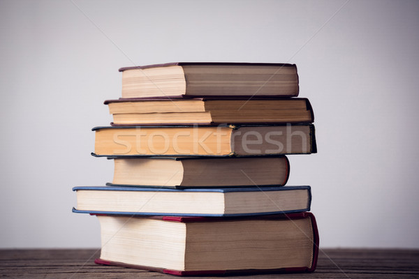 Stack of books on table against wall Stock photo © wavebreak_media