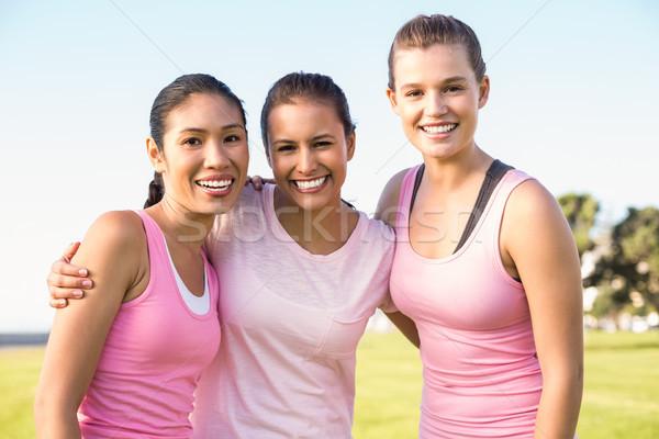Három mosolyog nők visel rózsaszín mellrák Stock fotó © wavebreak_media