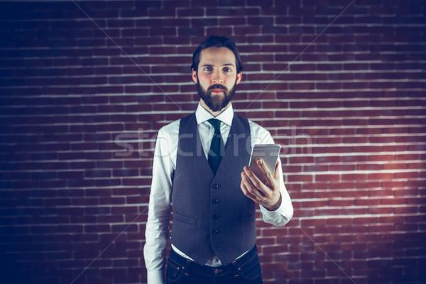 Portré komoly hipszter okostelefon téglafal telefon Stock fotó © wavebreak_media
