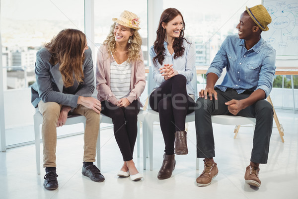 Souriant gens d'affaires séance président bureau femme Photo stock © wavebreak_media