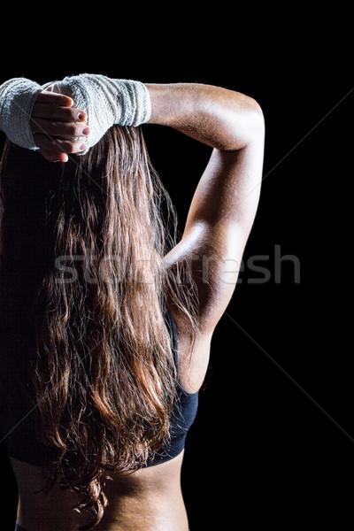 Vista posteriore femminile boxer lungo capelli castani piedi Foto d'archivio © wavebreak_media