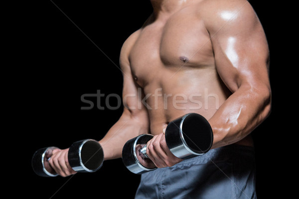Mid section of a bodybuilder with dumbbells Stock photo © wavebreak_media