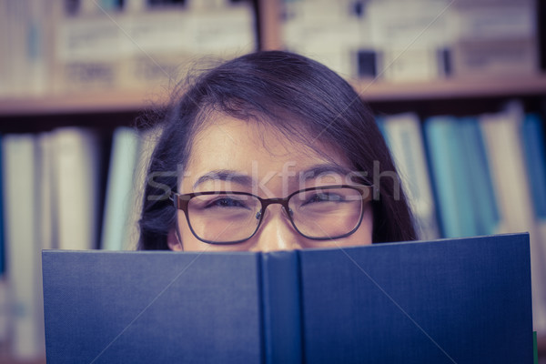 довольно студент сокрытие лице за книга Сток-фото © wavebreak_media