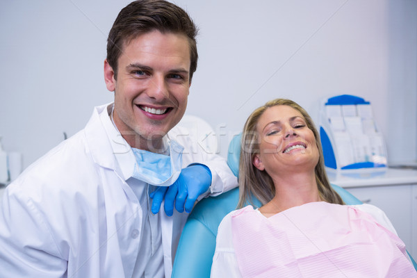 Portrait of smiling patient and dentist sitting on chair Stock photo © wavebreak_media