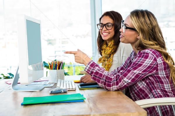 Two girls use a computer Stock photo © wavebreak_media