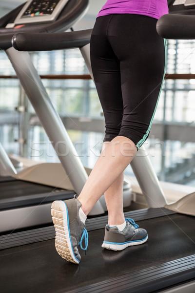 Verlagen geschikt vrouw tredmolen gymnasium Stockfoto © wavebreak_media