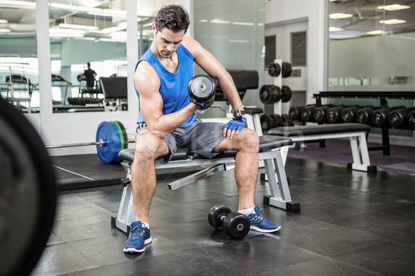 Izmos férfi emel súlyzó ül pad Stock fotó © wavebreak_media