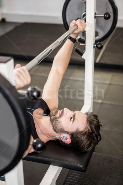 Muscolare uomo bilanciere panchina palestra Foto d'archivio © wavebreak_media