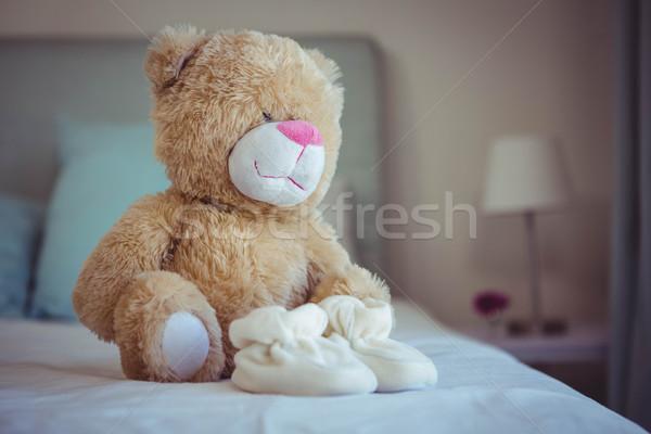 Görmek oyuncak ayı bebek çorap yatak ev Stok fotoğraf © wavebreak_media