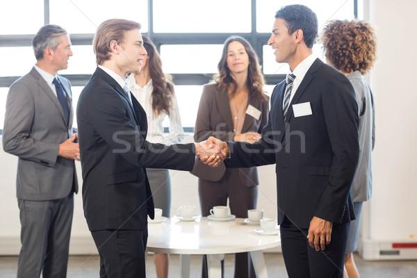 Businessman interacting with his team Stock photo © wavebreak_media