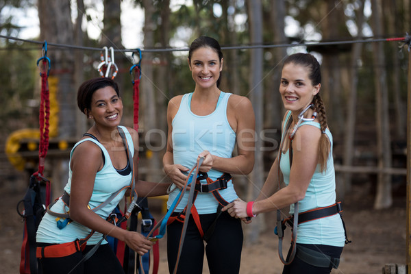 Female friends standing together in park Stock photo © wavebreak_media