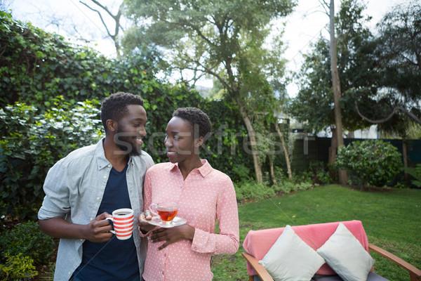 пару лимона чай черный кофе саду счастливым Сток-фото © wavebreak_media