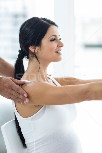 Doctor giving physiotherapy to pregnant woman Stock photo © wavebreak_media