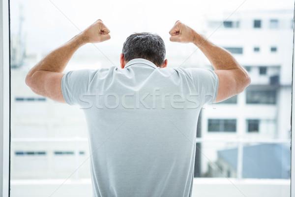 Tensed man leaning on glass window Stock photo © wavebreak_media