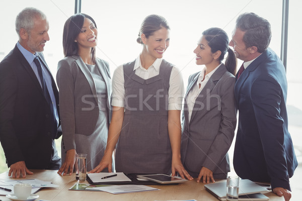 Businesspeople interacting in conference room Stock photo © wavebreak_media