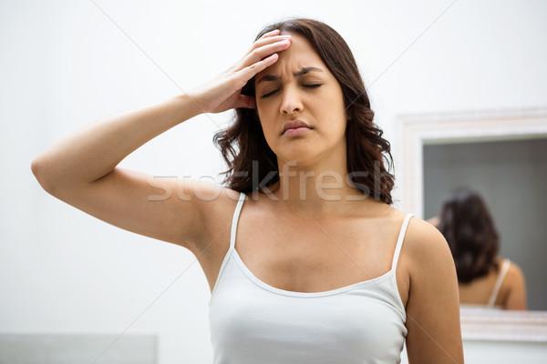 Young woman getting a headache Stock photo © wavebreak_media