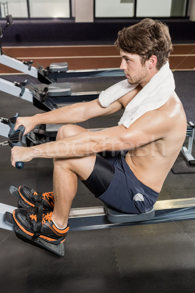 Homem remo máquina ginásio saúde Foto stock © wavebreak_media