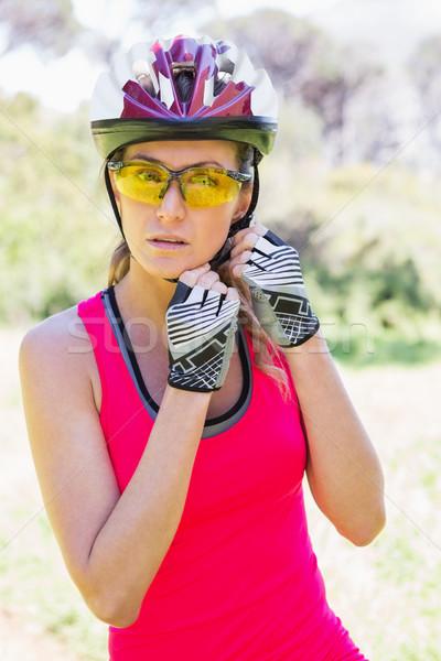 Woman opening her helmet Stock photo © wavebreak_media